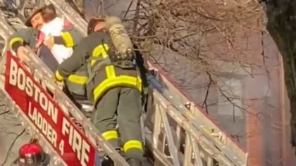 Woman, 2 children rescued from balcony during fire
